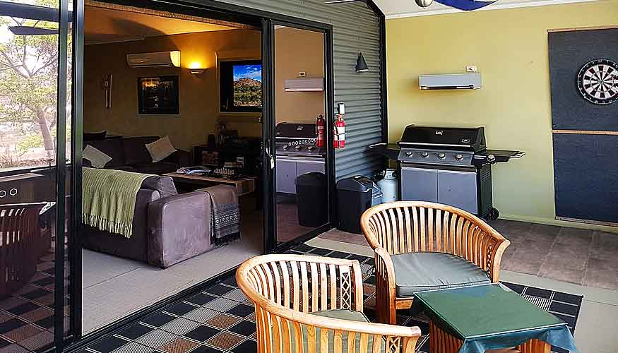 Private enclosed patio balcony with BBQ, table, dart board for fun and games